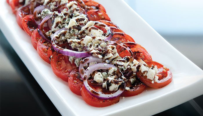 sliced tomatoes with blue cheese display image